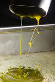 Extra virgin olive oil. Olive oil poor fall out an modern oil mill Royalty Free Stock Photos