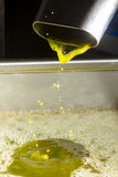 Extra virgin olive oil. Olive oil poor fall out an modern oil mill Stock Photography