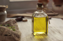 Extra virgin olive oil on rustic background. Olive oil on rustic background Stock Photos