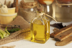 Extra virgin olive oil on rustic background. Olive oil on rustic background Stock Images