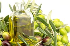Extra virgin olive oil. Surrounded by freshly harvested olives Stock Photography