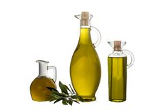 Extra Virgin olive oil in three rustic  bottle and jar  isolated. Over a white back stock photography