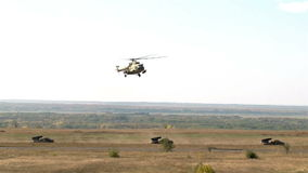 Extra Wind shot Military helicopter landing on battlefield. Outdoor stock video footage