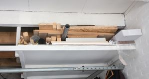 Extra wood and other stuff waiting to be used. Storage in a private garage Stock Photography