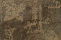 Extracción del petróleo Dibujando en una roca, a propósito del aceite Fotos de archivo