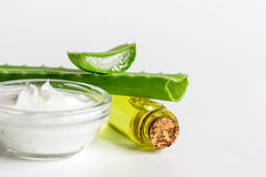 Extract from aloe vera in glass bottle and cream macro Stock Photography