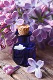 Extract from the fragrant lilac flowers close up on the table Royalty Free Stock Photo