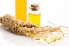 Extract of ginseng root. With plant royalty free stock images