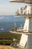 Transmission mast in detail with wooded area in the background stock photography