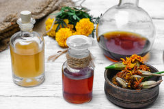 Extract from marigolds. Medical extract decoction from the flowers of marigold royalty free stock images