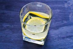 Lemon drink. Extract of organic lemon with fresh lemon stock photos