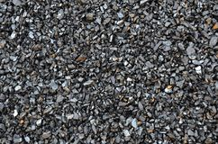 Extracted and enriched coal anthracite fines. Extracted and enriched coal anthracite fines is scattered Royalty Free Stock Photos