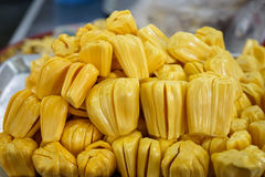Extracted flesh jackfruit in bright yellow color selling on meta. L tray in local market with blurred background, Angsila, Chonburi Royalty Free Stock Image