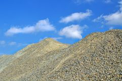 Extracted gravel on pile. At mining site, background stock photo