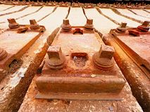 Extracted old concrete sleepers in stock. Old  rusty used concrete railway ties stored Royalty Free Stock Photo