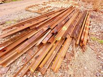 Extracted old rails in stock. Old  rusty used concrete railway ties stored Royalty Free Stock Image
