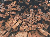 Extracted old wooden ties in stock. Old oiled used oak railway sleepers stored after reconstruction Royalty Free Stock Photo