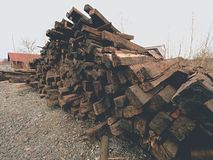 Extracted old wooden ties in stock. Old oiled used oak railway sleepers stored after reconstruction Stock Photos