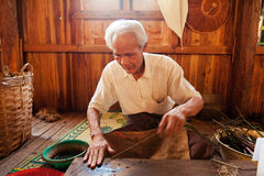Extracting lotus threads, Myanmar Stock Photos