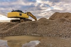 Extracting stone for its transformation into gravel for the construction of a road stock photography