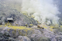 extracting sulphur inside Kawah Ijen crater Royalty Free Stock Image