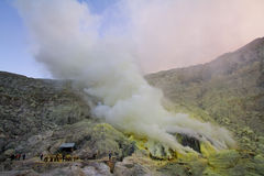 Extracting sulphur inside Kawah Ijen crater Stock Image