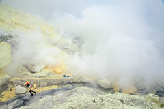 Extracting sulphur inside Kawah Ijen crater Stock Photos