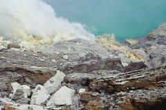 Extracting sulphur inside Kawah Ijen crater Stock Photo