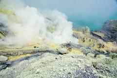 Extracting sulphur inside Kawah Ijen crater Stock Photos
