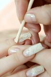 Extraction of cuticle. With surface of nail stock photos