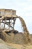 Extraction de sable pour la production Photographie stock libre de droits