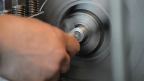 Extraction of the manufactured part from the lathe chuck. Metal working of metals by cutting stock footage