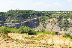 Extraction of mineral resources in granite quarry Stock Photography