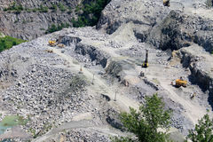 Extraction of mineral resources in a granite quarry Royalty Free Stock Images