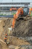Extraction of a pipe by means of an excavator royalty free stock images