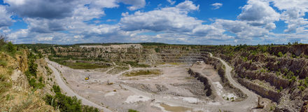 Extraction in the quarry. Panoramic view of granite stone extraction in the quarry Royalty Free Stock Images