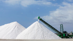 Extraction of salt. Salt mountains on blue sky Stock Photography