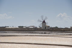 Extraction of salt in Trapani in Sicily. Windmill for the extraction of salt Royalty Free Stock Images