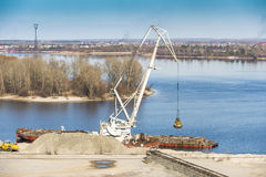 Extraction of sand on the river. Extraction of river sand spring cranes royalty free stock photos