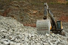 Extraction of stone in the quarry Royalty Free Stock Image