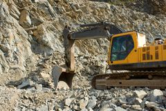 Extraction of stone in the quarry Stock Photography