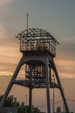 Extraction tower. The restored tower exhaust. It was part of the now-defunct mine. This picture was taken at sunset. Country. Poland, Region: Upper Silesia Royalty Free Stock Photo