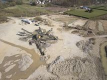 Extraction, washing, sorting and distraction of river gravel. Mining industry. Technology of obtaining a stone. A bird`s eye view. Shooting with a quadrocopter royalty free stock photography