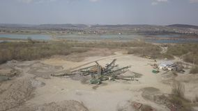 Extraction, washing, sorting and distraction of river gravel. Mining industry. Technology of obtaining a stone. A bird`s eye view. Shooting with a quadcopter stock footage
