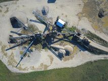 Extraction, washing, sorting and distraction of river gravel. Mining industry. Technology of obtaining a stone. A bird`s eye view. Shooting with a quadrocopter stock photography