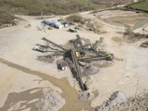 Extraction, washing, sorting and distraction of river gravel. Mining industry. Technology of obtaining a stone. A bird`s eye view. Shooting with a quadrocopter royalty free stock images