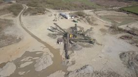 Extraction, washing, sorting and distraction of river gravel. Mining industry. Technology of obtaining a stone. A bird`s eye view. Shooting with a quadcopter stock video