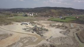 Extraction, washing, sorting and distraction of river gravel. Mining industry. Technology of obtaining a stone. A bird`s eye view. Shooting with a quadcopter stock video footage