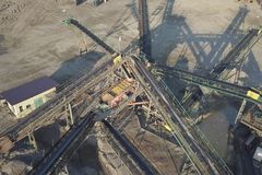 Extraction, washing, sorting and distraction of river gravel. Mining industry. Technology of obtaining a stone. A bird`s eye view. Shooting with a quadrocopter stock images