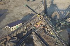 Extraction, washing, sorting and distraction of river gravel. Mining industry. Technology of obtaining a stone. A bird`s eye view. Shooting with a quadrocopter stock image